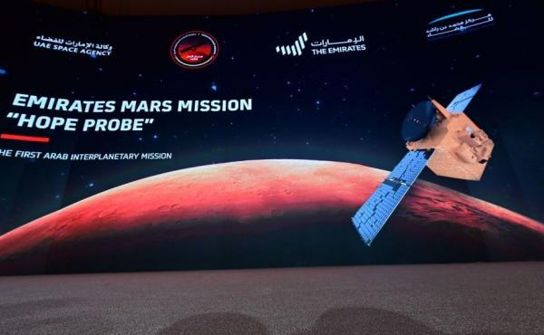 """A picture taken on July 19, 2020, shows a screen broadcasting the launch of the """"Hope"""" Mars probe at the Mohammed Bin Rashid Space Centre in Dubai. """"Hope"""" — Al-Amal in Arabic — is expected to start orbiting Mars this week, marking the 50th anniversary"""