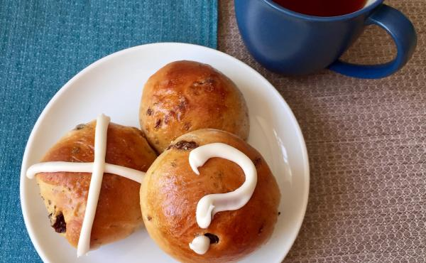 Decorating Easter buns with a variety of symbols is an inclusive way to share holiday food.