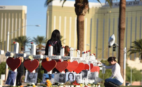 Fifty-eight white crosses for the victims of the shooting on the Las Vegas Strip earlier this month are arrayed Oct. 6 just south of the Mandalay Bay hotel. The shooter fired down on a crowd of concertgoers from a room in the hotel, and on Thursday its pa
