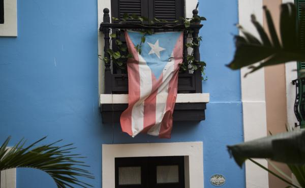 A Puerto Rican flag hangs from the balcony of a house in San Juan, Puerto Rico, on May 1.