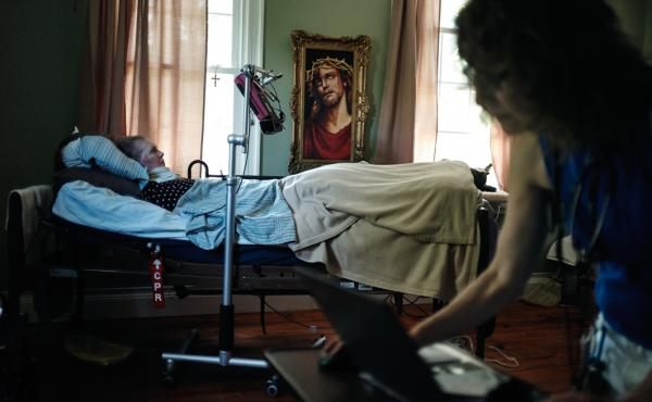 Dr. Miller checks medical records of Patricia Gillihan, 71.