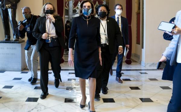 """House Speaker Nancy Pelosi, D-Calif., said that impeaching President Trump is """"a constitutional remedy that will ensure that the republic will be safe from this man."""" She's seen here walking to the House floor Wednesday ahead of the vote."""