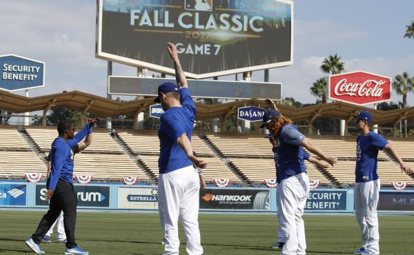 Players warm up before Game 7 of the World Series between the Houston Astros and the Los Angeles Dodgers.