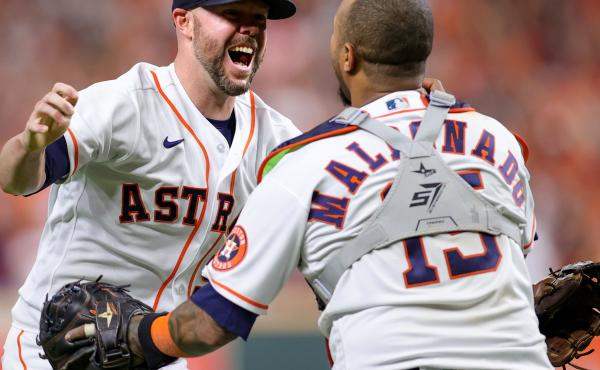 Ryan Pressly of the Houston Astros celebrates with Martin Maldonado after the final out in the ninth inning, defeating the Boston Red Sox 5-0 on Friday  and advancing to the World Series.