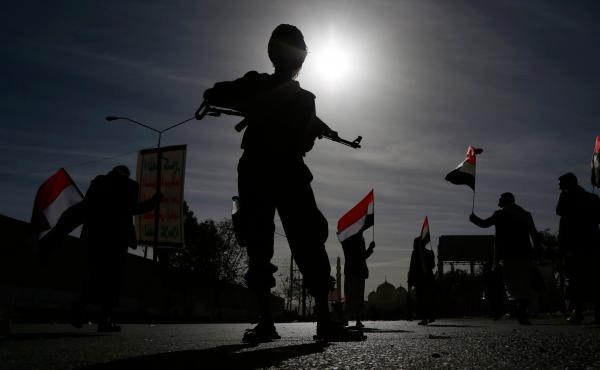 A Houthi soldier stands guard during a rally to mark the fourth anniversary of the war in Yemen on March 26, 2019 in Sana'a, Yemen.