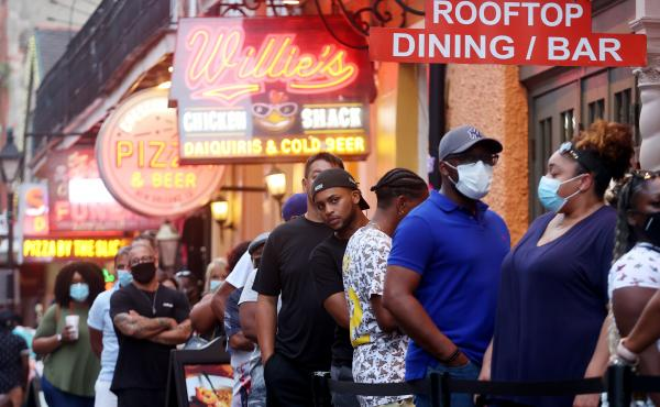 People queue to enter a restaurant in New Orleans' French Quarter in early August.