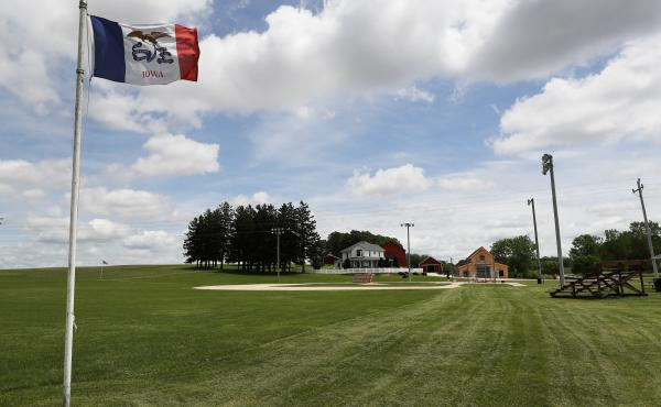 An Iowa flag waves over the field at the Field of Dreams movie site in Dyersville, Iowa, on June 5, 2020.