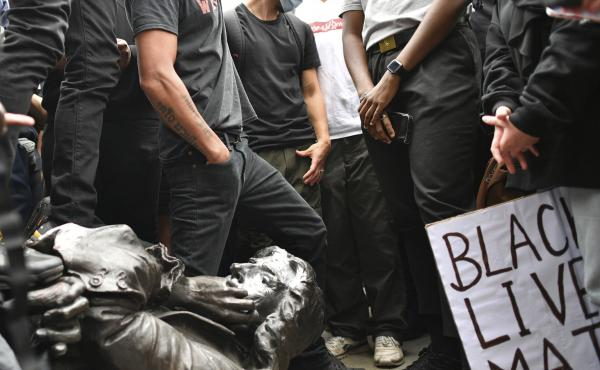Protesters pull down a statue of slave trader Edward Colston during a Black Lives Matter protest on College Green, Bristol, England, on Sunday. The protest grew in response to the recent killing of George Floyd by police officers in Minneapolis that spark