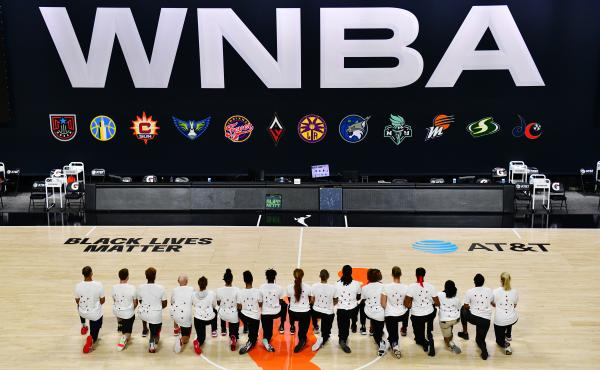 After the WNBA announcement of the postponed games for the evening, the Washington Mystics each wear white T-shirts with seven bullets on the back protesting the shooting of Jacob Blake by Kenosha, Wisconsin police at Feld Entertainment Center on August 2