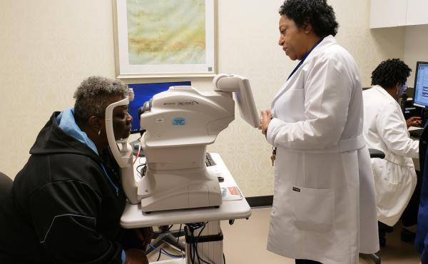Nurse practitioner Debra Brown guides patient Merdis Wells through a diabetic retinopathy exam at University Medical Center in New Orleans.