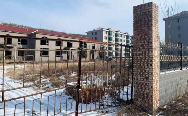 According to Zhang Zhixiong's family, Juxin Mining Co. paid for several village infrastructure projects, including building new apartment complexes for local residents. The buildings were weeks away from completion before Zhang was arrested and now stand