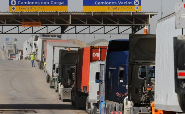 Trucks wait to enter the United States at the border crossing in Tijuana, Mexico, in 2017. More than $1.6 billion in goods flow across the border each day.