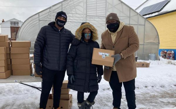 From left, Raphael Wright, Ederique Goudia and Jermond Booze, the team behind Taste the Diaspora, pictured with shoebox lunches in February.