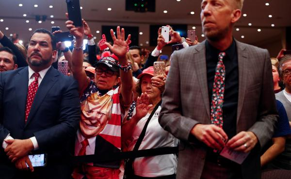 Audience members react as President Trump delivers remarks in January 2020 at an Evangelicals for Trump coalition launch at the King Jesus International Ministry in Miami.