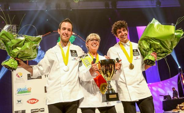 Ten international cheesemongers competed to be named the best cheesemonger in the world at Mondial du Fromage. Nathalie Vanhaver, from Belgium, in center, took gold. Christophe Gonzalez, from France, on the left, won silver; and for the first time ever, a