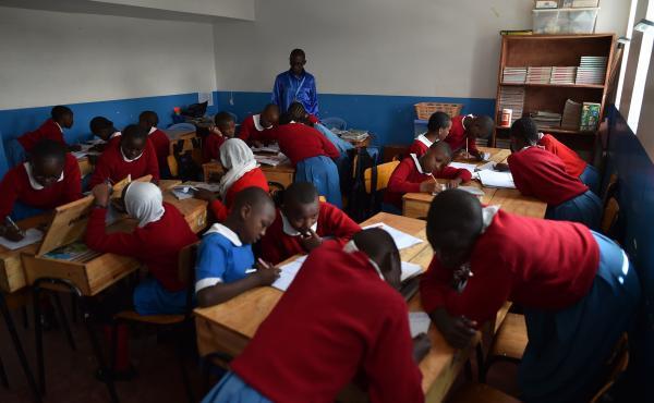 Students work on a classroom exercise at a school in Kibera, a poor neighborhood in Nairobi, Kenya.