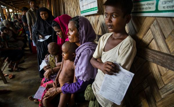 Rohingya refugees wait for medical treatment at a 'Doctors Without Borders clinic in Cox's Bazar, Bangladesh.