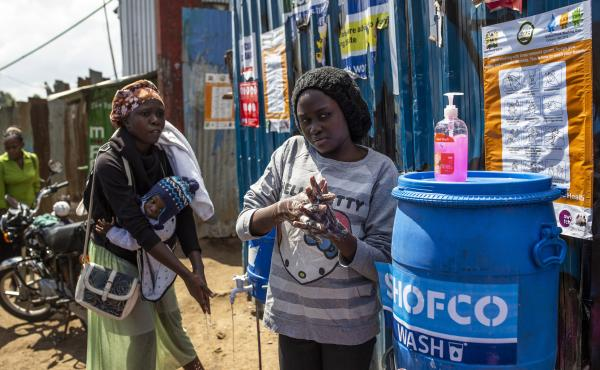 Residents wash their hands at a station set up by Shining Hope for Communities in Kibera, a neighborhood in Nairobi, Kenya, where running water is scarce.