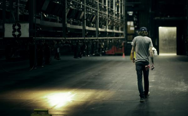 A person walks backstage.