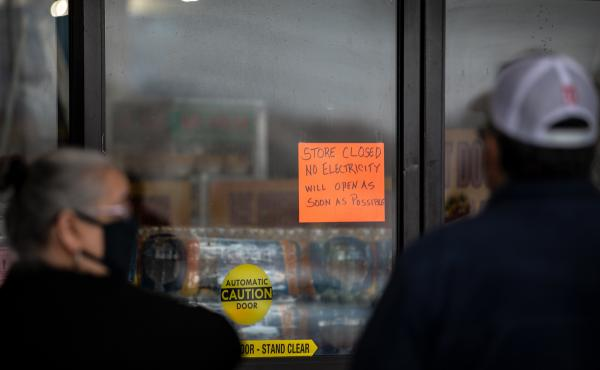 People wait in line for Fiesta Mart to open after the store lost electricity in Austin, Texas on February 17, 2021.