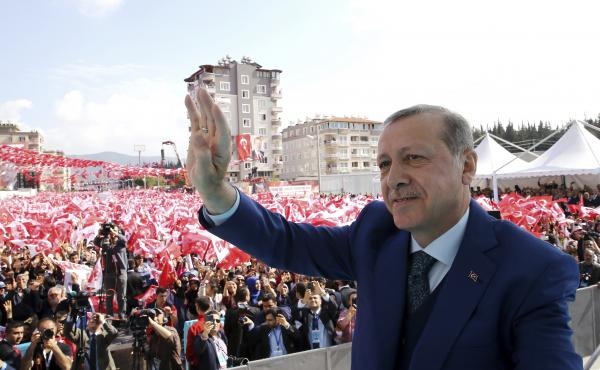 """Turkish President Recep Tayyip Erdogan addresses supporters Friday in the southern province of Hatay. Erdogan says the U.S. missile strike on a Syrian air base is a """"concrete step"""" but argues that it's not enough."""