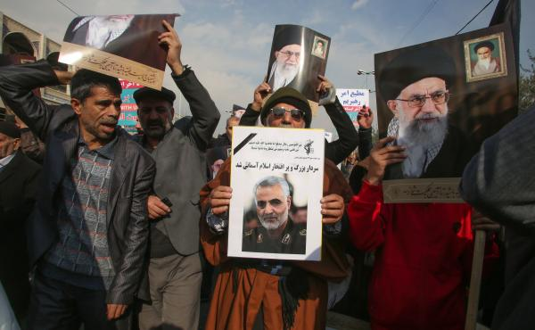 Iranian demonstrators hold posters of slain Maj. Gen. Qassem Soleimani (center) and the country's supreme leader, Ayatollah Ali Khamenei, during a rally Friday in the capital, Tehran. The U.S. strike on the military leader in Baghdad has elicited warnings