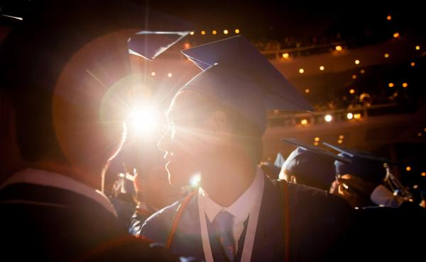 Sam Marsenison, 18, stands among classmates after accepting his high school diploma in Fort Lauderdale, Fla.