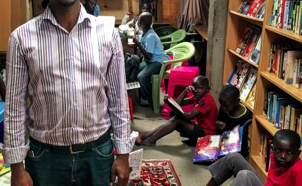 Douglas Ng'ang'a in his home, which he has converted into a community library.