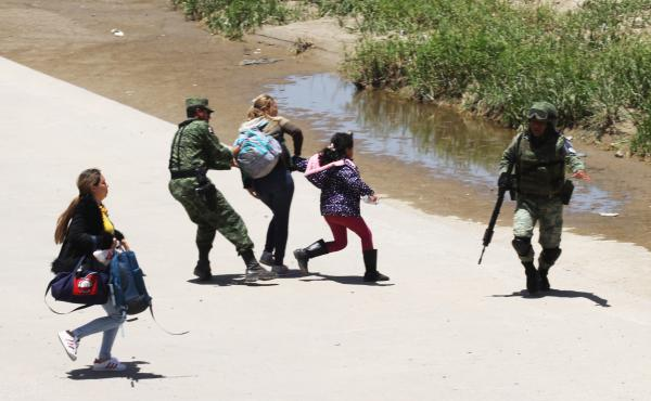 Mexican National Guard members prevent Central American migrants from trying to cross the Rio Grande from Juárez, Mexico, on June 21.
