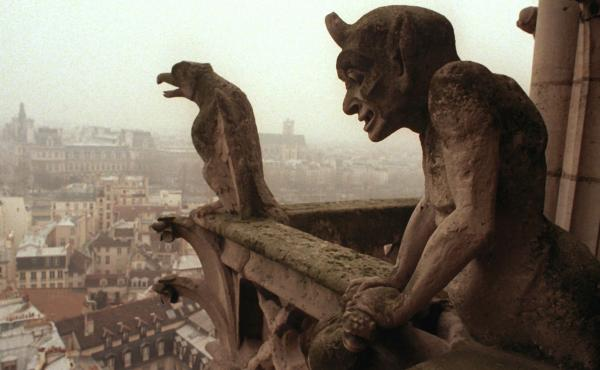 Gargoyles watch over the streets of Paris from the top of the Notre Dame Cathedral in 1996.