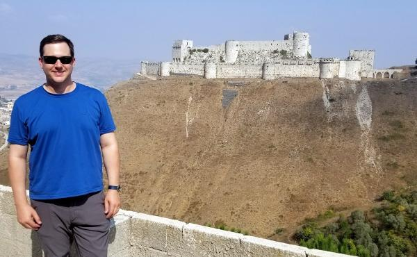 Stefan Krasowski, co-founder of the Reach For The Miles meetup, stands in front of Krak des Chevaliers in western Syria. The war-torn country was the last one that Krasowski, who has since turned 40, had yet to visit.