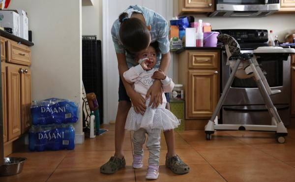 Kai worries he could give COVID-19 to his 2-year-old sister, Alaina. She was born with a heart condition, Down syndrome and a fragile immune system.