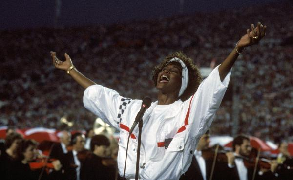 """At Florida's Tampa Stadium in 1991, Whitney Houston delivered an iconic performance of """"The Star Spangled Banner"""" to kick off Super Bowl XXV."""