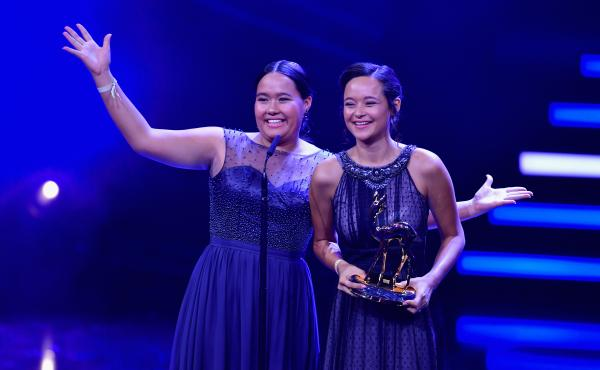 """Teenage sisters Melati and Isabel Wijsen of Bali have received many honors for their efforts to ban plastic bags. Above: They accept the 2017 """"Award for Our Earth"""" from Germany's Bambi Awards."""