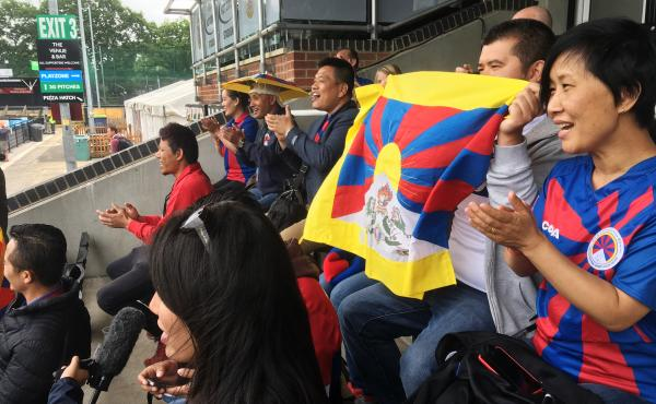 Tibetans cheer on a Tibetan team at a soccer tournament in London. Fans say they were pleased and surprised that the tournament organizers didn't succumb to pressure from potential sponsors and dump the Tibetan team to avoid angering the Chinese governmen