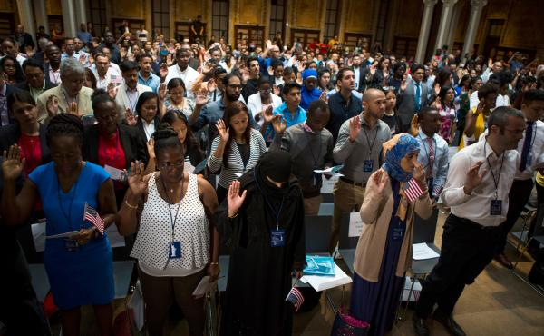 Naturalization candidates take the Naturalization Oath of Allegiance in June at the New York Public Library. Over 190 immigrants from 59 countries became American citizens.