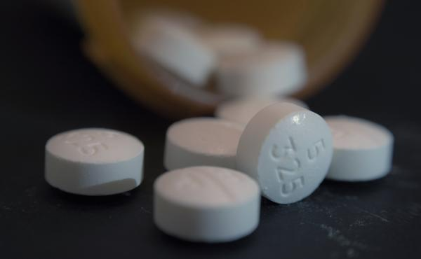 An arrangement of pills of the opioid oxycodone-acetaminophen, also known as Percocet, in New York. A new report finds a link between workforce participation and the prescription rate of opioids in the U.S.