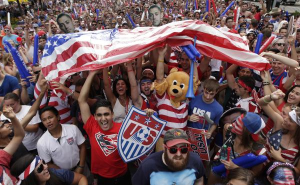 A raucous crowd cheers for Team USA during a Tuesday, July 1, 2014 World Cup soccer match between the U.S. and Belgium at a public viewing party in Detroit, Tuesday, July 1, 2014. For many fans during next year's U.S.-free World Cup, it'll be just another