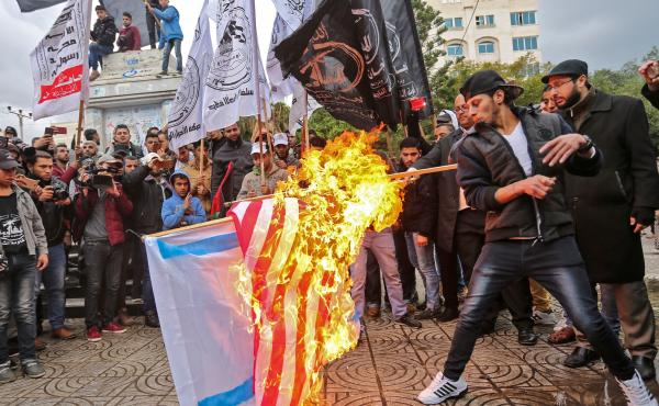 Palestinian protesters burn U.S. and Israeli flags in Gaza City on Wednesday. President Trump has recognized Jerusalem as Israel's capital, upending decades of U.S. policy and ignoring dire warnings from allies.