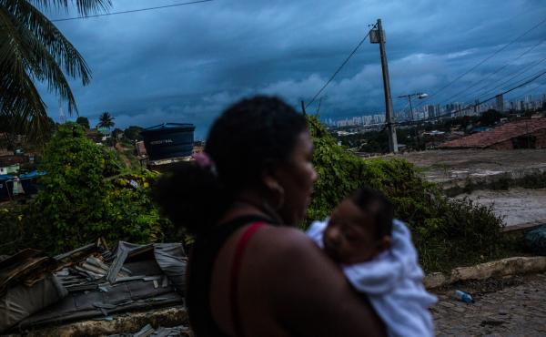 Nadja Bezerra carries her 4-month-old daughter, Alice, who was born with microcephaly, in Recife, Brazil.