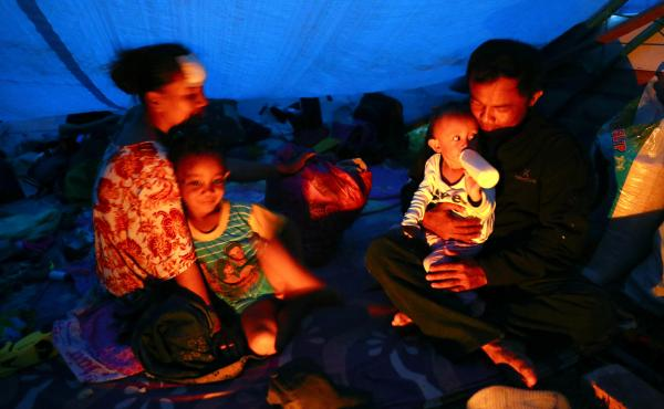 Relief agencies are mobilizing to help thousands of people affected by Indonesia's earthquake and tsunami. Here, people are seen taking refuge in a temporary shelter in Palu, Central Sulawesi, on Tuesday.