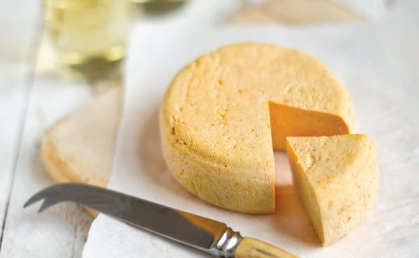 True cheddar cheese can take months — even years — to age. So Claudia Lucero created a faux-cheddar that can be made in very little time.