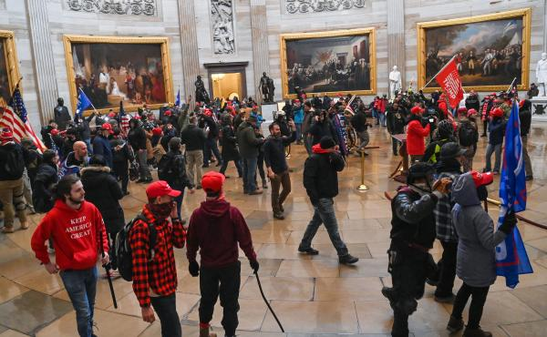 Supporters of President Trump roam the U.S. Capitol Rotunda after storming into the building on Wednesday.