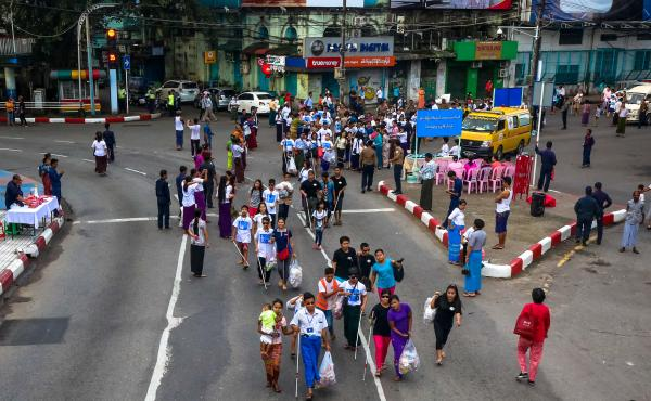 Members of the visually-impaired community, volunteers, local organizations and the Myanmar Red Cross Society participate in the 2017 White Cane Day walk in downtown Yangon. Yangon, Myanmar.