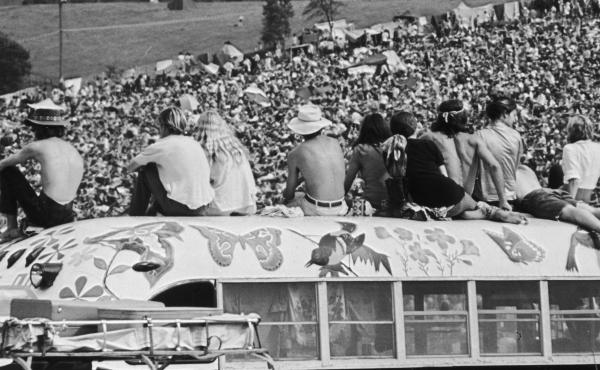 Fans sit atop a painted bus at the Woodstock Music Festival  in Bethel, N.Y., in August 1969.