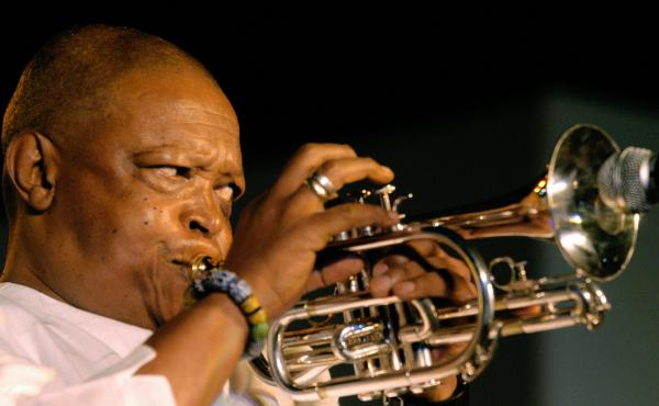 South African musician Hugh Masekela, performs in New Delhi in 2004.