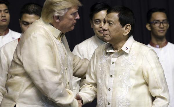 President Trump shakes hand with Philippines President Rodrigo Duterte during the gala dinner marking ASEAN's 50th anniversary in Manila, Philippines, on Sunday.