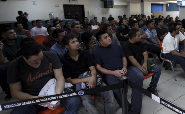 Salvadoran deportees, pictured in June 2018, listen to instructions from an immigration officer at La Chacra Immigration Center in San Salvador, El Salvador. A Human Rights Watch Report found that 138 repatriated Salvadorans have been killed since 2013. M