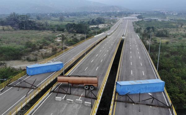 The Tienditas bridge connecting Colombia and Venezuela has been blocked by Venezuelan military forces, as seen here on Wednesday. Opposition leader Juan Guaidó and U.S. Secretary of State Mike Pompeo are demanding that humanitarian aid be allowed to ente