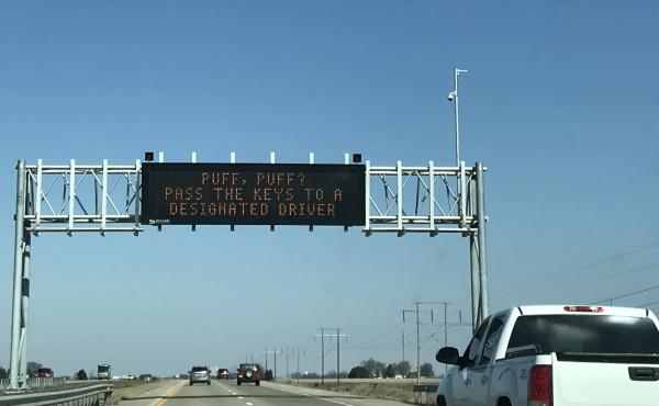 "Highway sign that reads, ""Puff, puff? Pass the keys to a designated driver."""